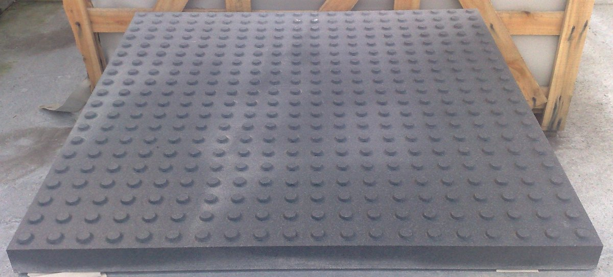 Blister tactile tile, buttons placed according the Spanish standard, in black granite.